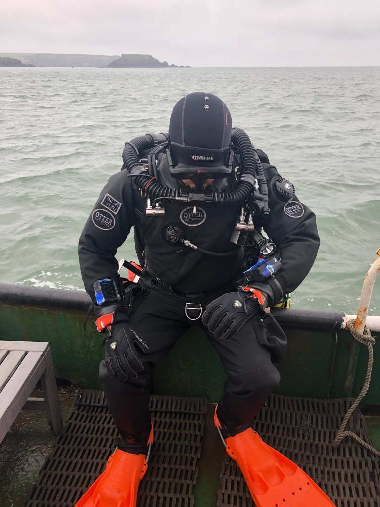 Diver preparing to roll off a dive boat